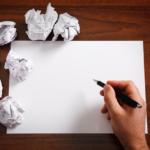 Writer staring at blank paper